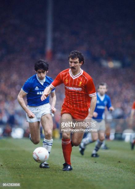 Graeme Souness of Liverpool being chased by Alan Irvine of Everton during the League Cup Final at Wembley Stadium on March 25, 1984 in London,...