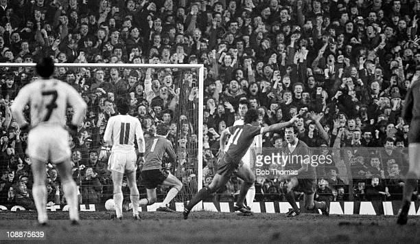 Graeme Souness of Liverpool celebrates in front of the Kop after scoring the 5th goal, and completing his hat-trick, during the European Cup 3rd...