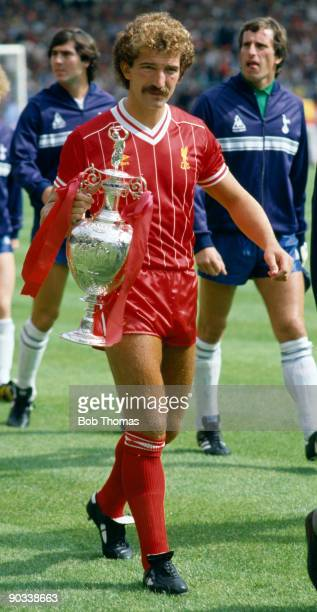 Graeme Souness of Liverpool holding the Division 1 League Championship trophy after the Liverpool v Tottenham Hotspur FA Charity Shield match played...