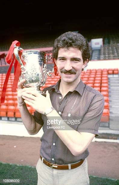 Graeme Souness of Liverpool stands beside the player's tunnel and the home dug out with the League Cup trophy during a photocall held at Anfield in...
