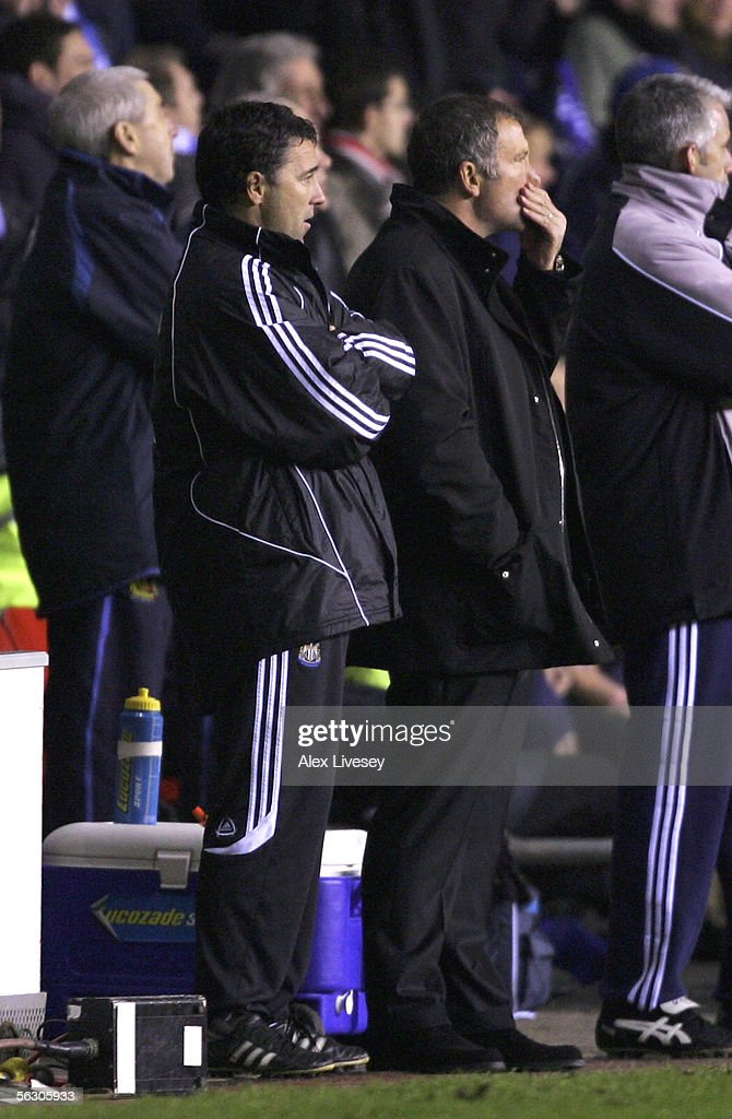 Graeme Souness the manager of Newcastle United (R) and his assistant, Dean Saunders (L), look on as they are defeated by Wigan Athletic during the Carling Cup fourth round match between Wigan Athletic and Newcastle United at the JJB Stadium on November 30, 2005 in Wigan, England