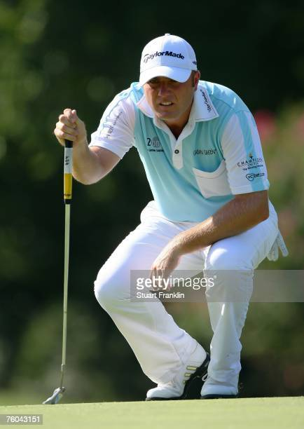 Graeme Storm of England lines up a putt during the first round of the 89th PGA Championship at the Southern Hills Country Club on August 9 2007 in...
