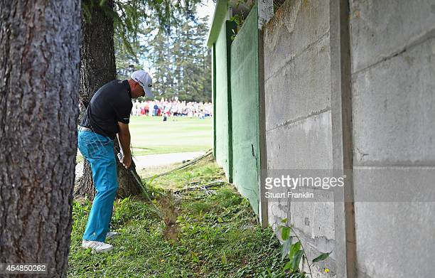 Graeme Storm of England plays his shot by the wall on the 18th hole during the playoff against David Lipsky of USA during the final round of the...