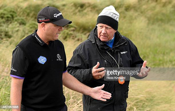 Graeme Storm of England talikng to a referee during his match against Andrew Johnston of England in the first round of the Saltire Energy Paul Lawrie...