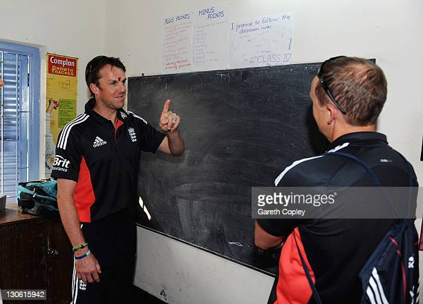 Graeme Swann and coach Andy Flower of England during a team visit to Future Hope School on October 27 2011 in Kolkata India The England cricket team...