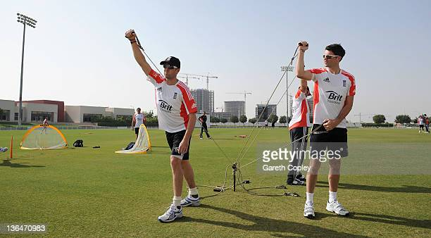 Graeme Swann and James Anderson of England warm up before a nets session at The ICC Global Academy on January 6 2012 in Dubai United Arab Emirates