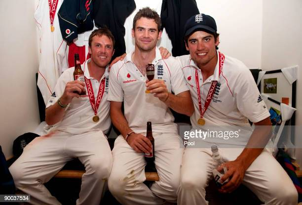 Graeme Swann James Anderson and Alastair Cook of England celebrate with the Ashes Urn in the changing room following the fifth npower Test Match at...