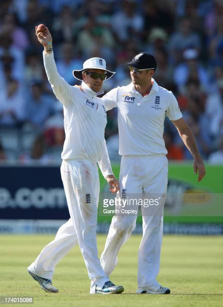 Graeme Swann of England acknowledges his five wicket haul with James Anderson during day two of the 2nd Investec Ashes Test match between England and...