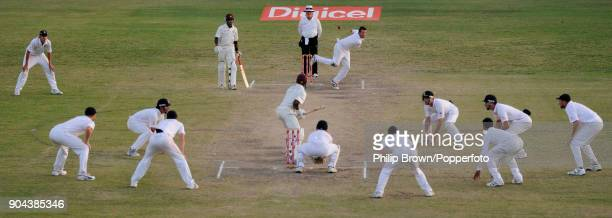 Graeme Swann of England bowling to West Indies batsman Daren Powell during the final overs of the 3rd Test match between West Indies and England at...