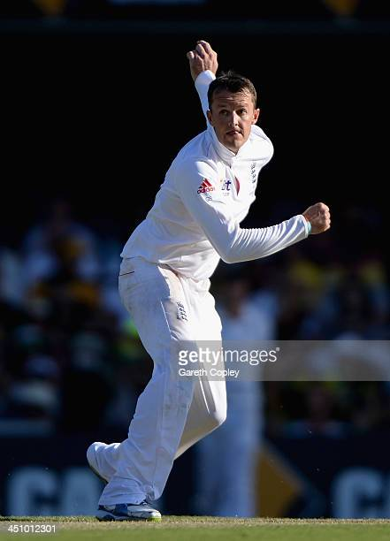 Graeme Swann of England bowls during day one of the First Ashes Test match between Australia and England at The Gabba on November 21 2013 in Brisbane...