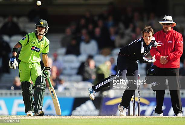 Graeme Swann of England bowls watched by Fawad Alam of Pakistan and umpire Richard Illingworth during the 3rd NatWest One Day International between...