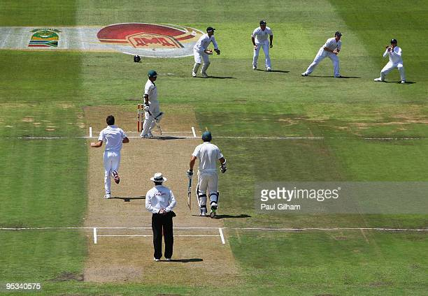 Graeme Swann of England catches out Ashwell Prince of South Africa off the bowling of James Anderson of England during day one of the second test...