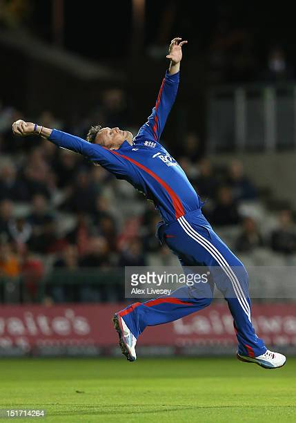 Graeme Swann of England catches the ball to take the wicket of JP Duminy of South Africa during the 2nd NatWest International T20 match at Old...