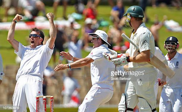 Graeme Swann of England celebrates after dismissing Peter Siddle of Australia to win the match during day five of the Second Ashes Test match between...