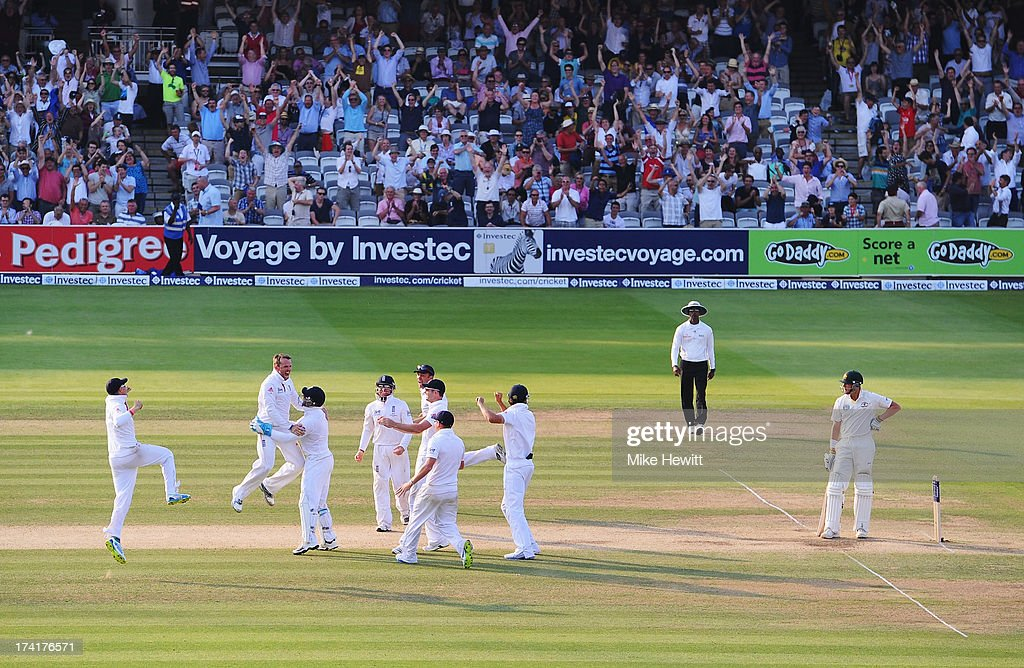 Graeme Swann of England celebrates taking the final wicket of James Pattinson of Australia with team mates during day four of the 2nd Investec Ashes Test match between England and Australia at Lord's Cricket Ground on July 21, 2013 in London, England.