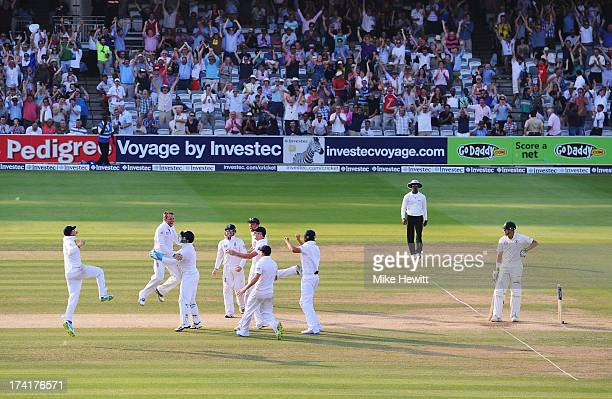 Graeme Swann of England celebrates taking the final wicket of James Pattinson of Australia with team mates during day four of the 2nd Investec Ashes...