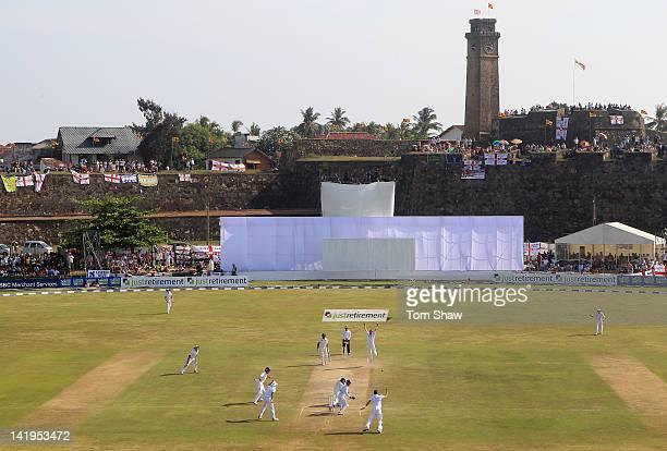 Graeme Swann of England celebrates taking the wicket of Mahela Jayawardene of Sri Lanka during day 2 of the 1st test match between Sri Lanka and...