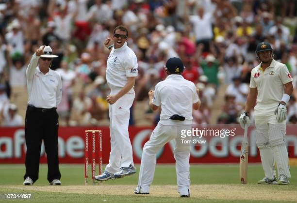 Graeme Swann of England celebrates taking the wicket of Simon Katich of Australia during day four of the Second Ashes Test match between Australia...