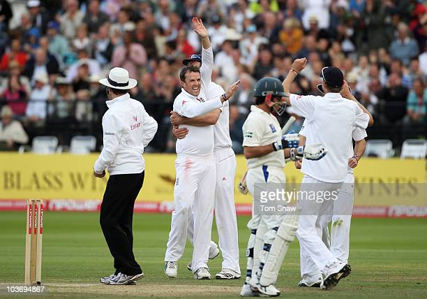Graeme Swann of England celebrates the wicket of Mohammad Asif of Pakistan with team mates during day three of the 4th npower Test Match between...
