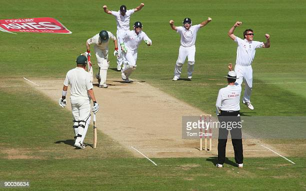 Graeme Swann of England celebrates the wicket of Simon Katich of Australia during day four of the npower 5th Ashes Test Match between England and...