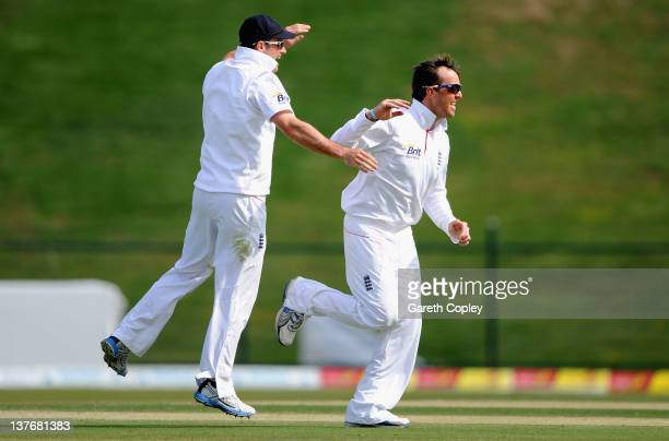 Graeme Swann of England celebrates with captain Andrew Strauss after dismissing Taufeeq Umar of Pakistan during the second Test match between...