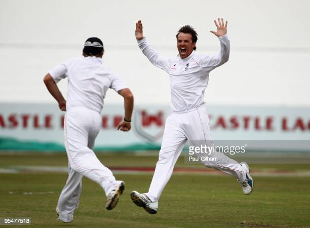 Graeme Swann of England celebrates with Ian Bell after taking the wicket of Ashwell Prince of South Africa for 16 runs when he was caught out by Ian...