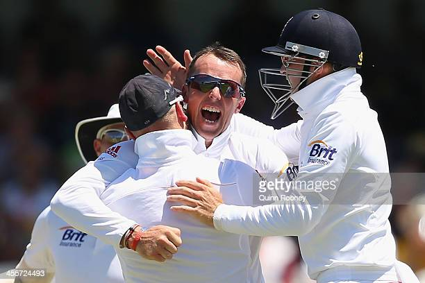 Graeme Swann of England is congratulated by team mates after getting the wicket of David Warner of Australia during day one of the Third Ashes Test...