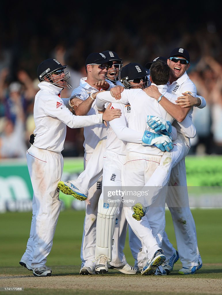 Graeme Swann of England is mobbed by team mates after taking the final wicket of James Pattinson of Australia giving England victory during day four of the 2nd Investec Ashes Test match between England and Australia at Lord's Cricket Ground on July 21, 2013 in London, England.