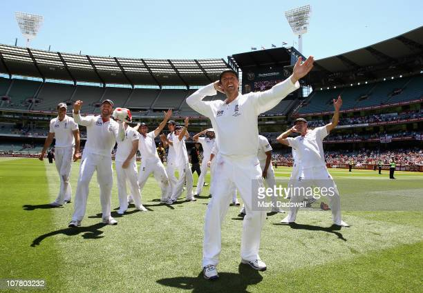 Graeme Swann of England leads the team doing the 'sprinkler dance' during day four of the Fourth Test match between Australia and England at the...
