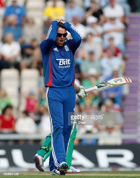 Graeme Swann of England looks on dejected after AB DeVilliers of South Africa is given not out during the 2nd NatWest Series ODI between England and...