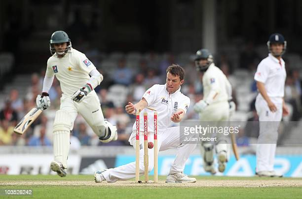 Graeme Swann of England runs out Azhar Ali of Pakistan during day four of the npower 3rd Test Match between England and Pakistan at The Brit...