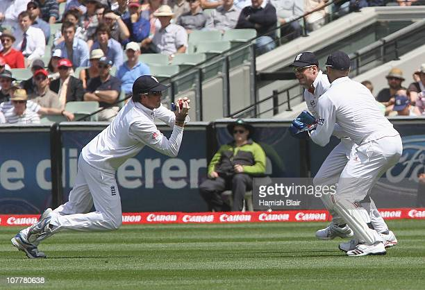 Graeme Swann of England takes a catch to dismiss Ricky Ponting of Australia with Matt Prior and Andrew Strauss of England looking on during day one...