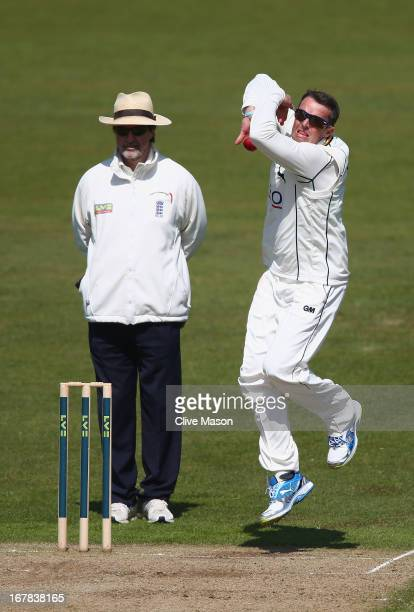 Graeme Swann of Nottinghamshire in action bowling during day three of the LV County Championship division one match between Nottinghamshire and...