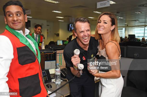 Graeme Swann representing Chance To Shine and Natalie Pinkham attend BGC Charity Day at One Churchill Place on September 11 2019 in London England