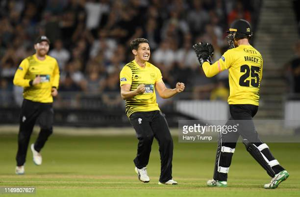 Graeme Van Buuren and James Bracey of Gloucestershire celebrate the wicket of James Hildreth of Somerset during the Vitality Blast match between...