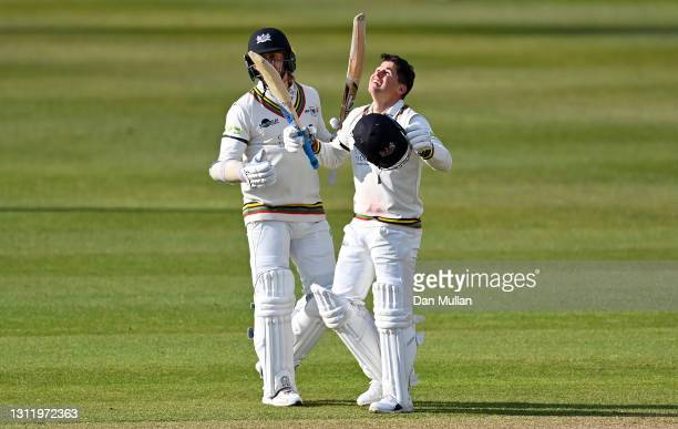 Graeme van Buuren of Gloucestershire celebrates reaching his century with Chris Dent of Gloucestershire during day four of the LV= County...