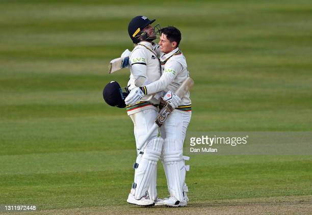 Graeme van Buuren of Gloucestershire celebrates with Chris Dent of Gloucestershire after scoring the winning runs to secure victory during day four...