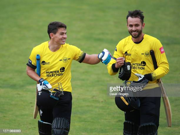 Graeme van Buuren of Gloucestershire jokes with team mate Jack Taylor at the close of the Gloucestershire innings during the T20 Vitality Blast 2020...
