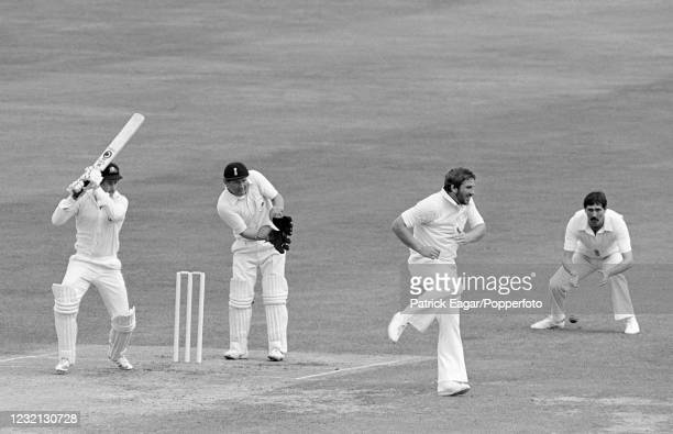 Graeme Wood of Australia drives the ball past England captain Ian Botham during his innings of 112 in the Centenary Test match between England and...