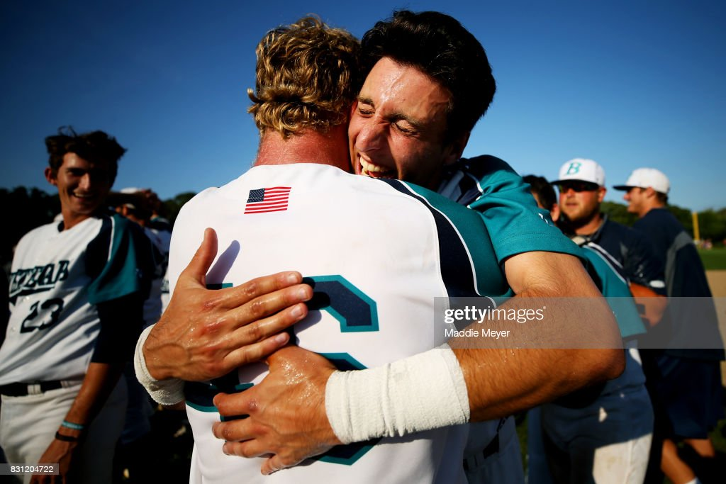 AJ Graffanino of the Brewster Whitecaps, right, hugs Chandler Taylor after they defeat the Bourne Braves to win the Cape Cod League Championship Series at Stony Brook Field on August 13, 2017 in Brewster, Massachusetts. The Cape Cod League was founded in 1885 and is the premier summer baseball league for college athletes. Over 1100 of these student athletes have gone on to compete in MLB including Chris Sale, Carlton Fisk, Joe Girardi, Nomar Garciaparra and Jason Varitek. The chance to see future big league stars up close makes Cape Cod League games a popular activity for the families in each of the 10 towns on the Cape to host a team. Each team is a non-profit organization, relying on labor from volunteers and donations from spectators to run each year.