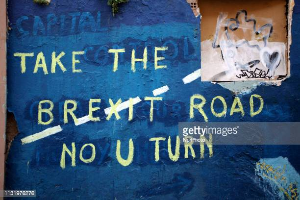 A graffiti about Brexit is seen in Athens city centre Greece on March 22 2019 The graffiti reads Take the Brexit Road No U Turn Theresa May asked for...