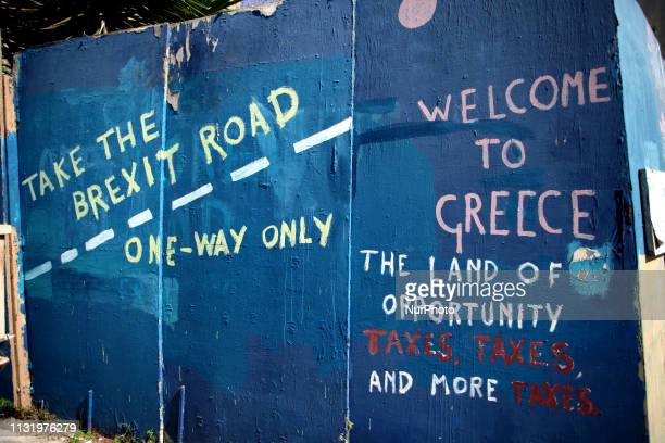 A graffiti about Brexit is seen in Athens city centre Greece on March 22 2019 The graffiti reads Take the Brexit Road One Way Only Theresa May asked...