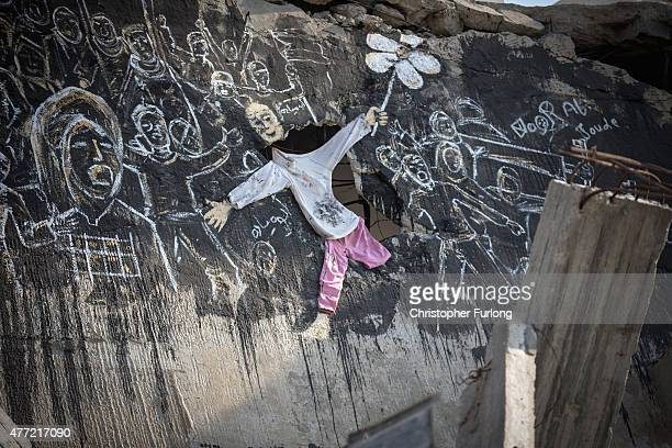 Graffiti adorns mounds of rubble of bombed buildings that continue to scar the landscape of Gaza on June 15 Gaza City Gaza The devastation across...