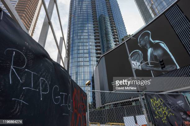 Graffiti and a mural memorialize former NBA star Kobe Bryant and his daughter Gigi who were killed in a helicopter crash in Calabasas California near...