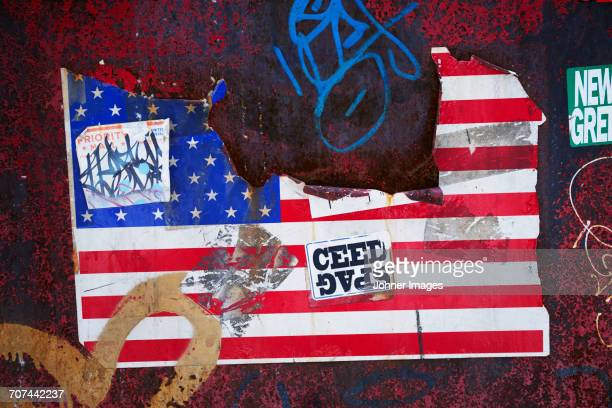 Graffiti and American flag on wall
