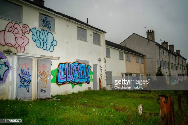 Graffiti and shutters cover abandoned homes on an estate at Gildas Avenue in Kings Norton on May 08 2019 in Birmingham England The empty buildings...