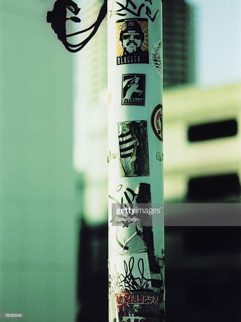 Graffiti and stickers on lamp post : Stock Photo