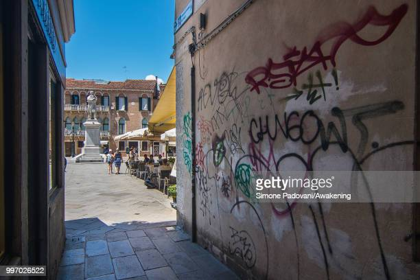 Graffiti and tags are seen on a wall of a calle that leads to Campo Santo Stefano close to Accademia bridge on the way that connect St Mark square to...
