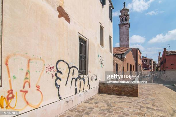Graffiti and tags are seen on the wall of a palace in Dorsoduro district on July 12 2018 in Venice Italy The plague of graffiti and tags on the walls...