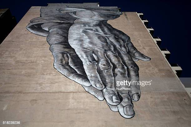 Graffiti art entitled 'Praying for us' by Manolis Anastasakos and the Kretisis bros on March 30 2016 in Athens Greece